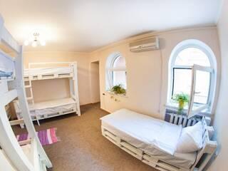 Кровать в общем женском или смешанном 8-ми местном номере
