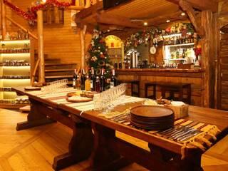"""Ресторан-колыба """"Oster-Platz"""" с камином и детской игровой комнатой. Настойки  карпатские в ассортименте."""