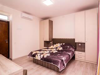 Однокомнатные апартаменты с кухней-студио и ванной комнатой.