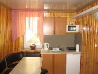 Фотографии апартаментов с двумя спальнями мини-отеля «Вилла Олива» в Затоке